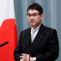 Justice Minister Katsuyuki Kawai tendered his resignation Thursday over his wife's alleged election law breach. | REUTERS