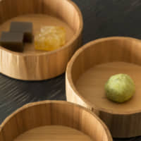 The perfect pairing: Wagashi Japanese sweets are an indispensable accompaniment to Japanese tea. The shop's selection ranges from its signature bite-sized sweets (photo front) to seasonal specialties. | RYOICHI OKAZAKI