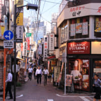 Bright lights, big city: The narrow alleys to the north of Tamachi Station are a cacophony of cluttered storefronts and bold signage. | KIT NAGAMURA