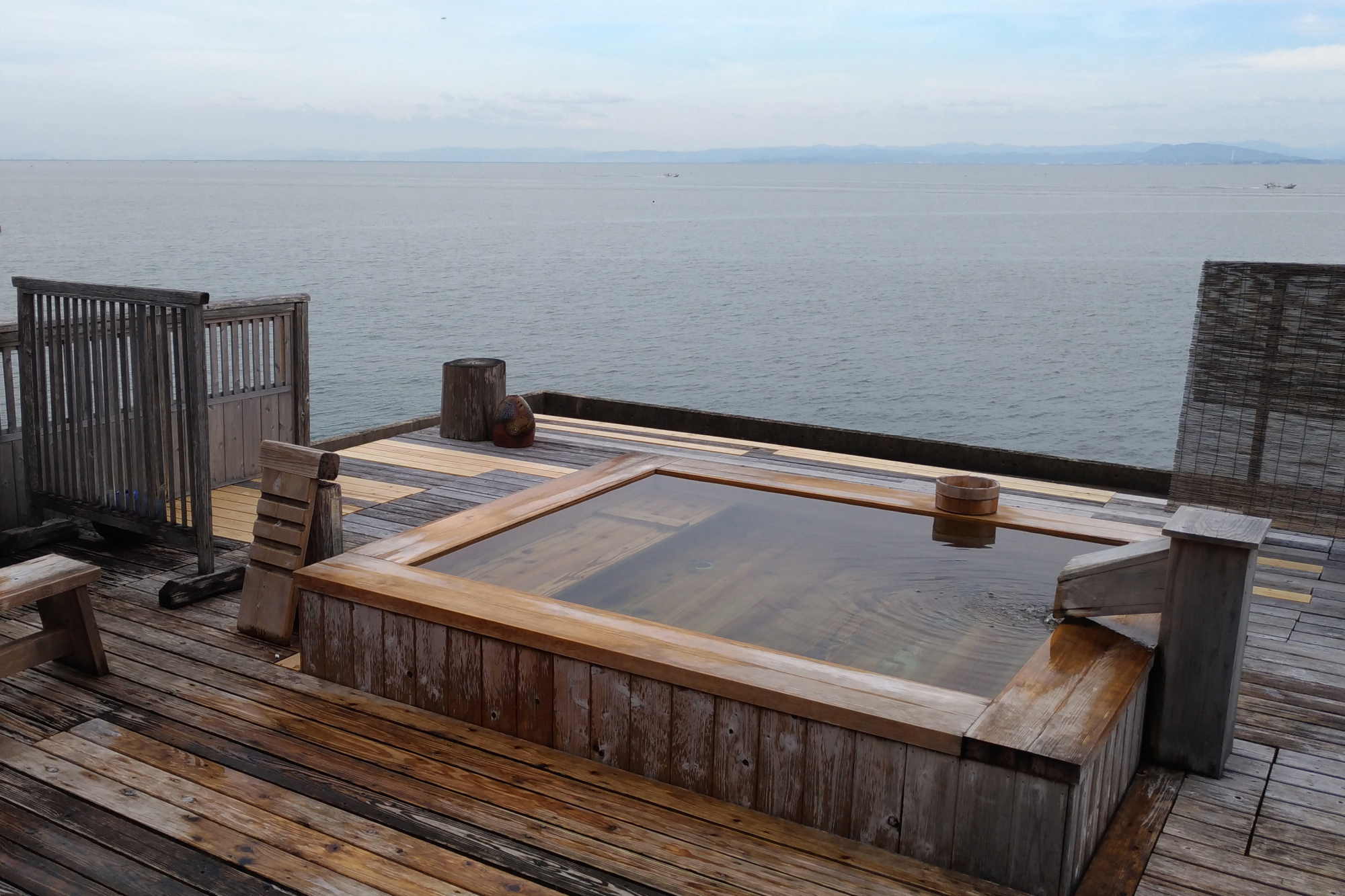 Sea and sky: Hoyosu Inn in Saga Prefecture has a private outdoor bath with excellent views over the Ariake Sea. | CHRIS OTT
