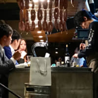 Casual chic: Tama's open kitchen is stylish but welcoming, and serves up one of the most interesting and unusual menus in Tokyo. | ROBBIE SWINNERTON