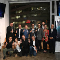 Representatives from eight startups taking part in the Global Startup Program with Italian Ambassador to Japan Giorgio Starace (back row, third from left) at a pitching event held on Sept. 11 at EDGEof in Shibuya Ward. | YOSHIAKI MIURA
