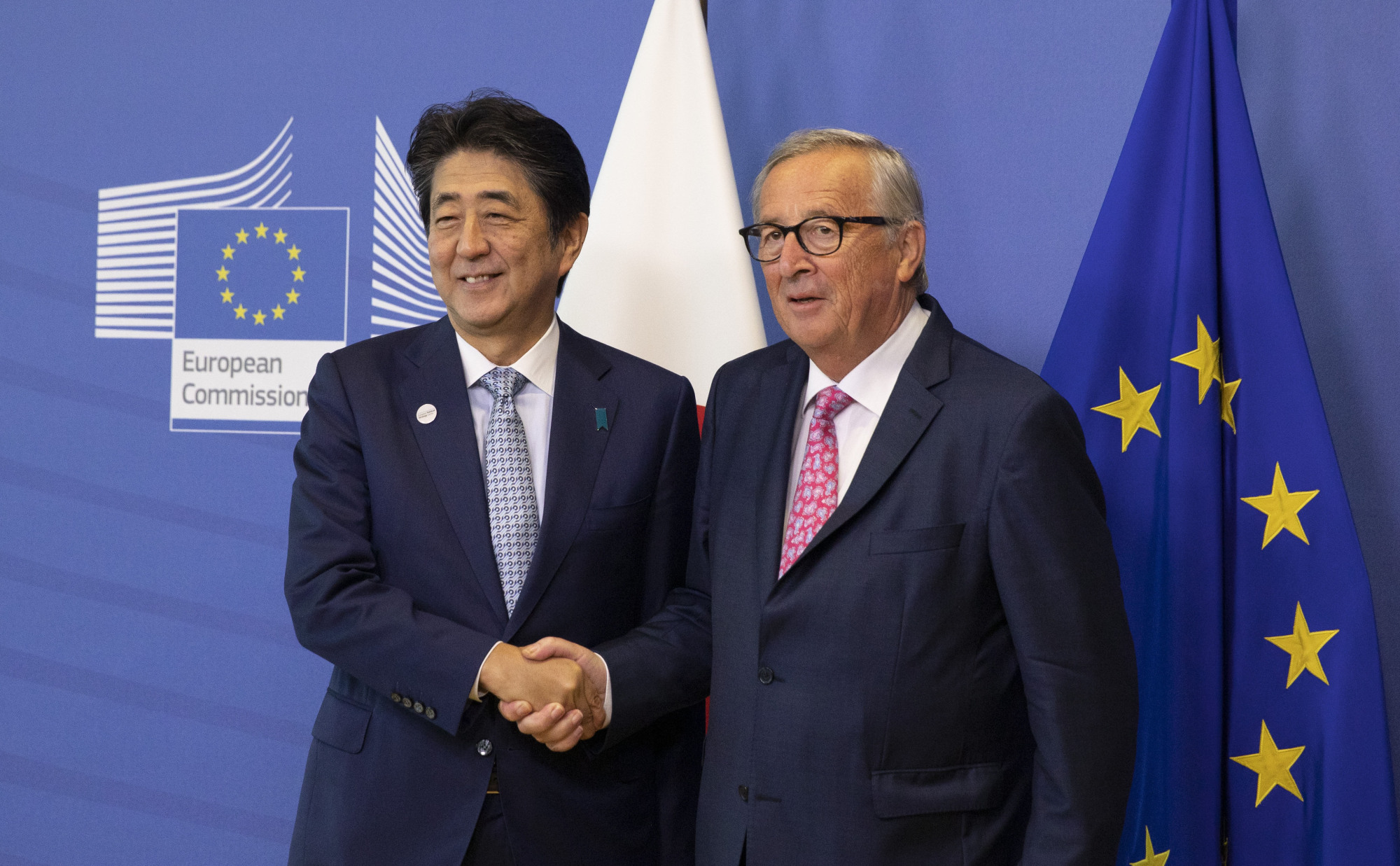 Prime Minister Shinzo Abe is greeted by European Commission President Jean-Claude Juncker prior to a meeting at EU headquarters in Brussels on Sept. 27. The new Japan-EU agreement is an important move in the right direction to meet China's international challenges.   AP