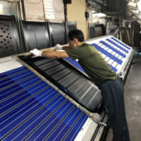 Fabric for Blooming Nakanishi handkerchiefs is screenprinted before being steamed and cut. | COURTESY OF BLOOMING NAKANISHI AND COMPANY