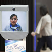 ANA and its competitors are betting that they can make money by keeping would-be travelers happily at home. | BLOOMBERG