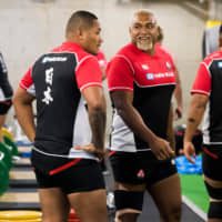 Japan's Isileli Nakajima (center) and fellow prop Asaeli Ai Valu (left) talk during a gym training session at Prince Chichibu Memorial Rugby Stadium on Wednesday, four days ahead of the Brave Blossoms' quarterfinal clash against South Africa. | AFP-JIJI