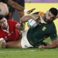 Damian  de Allende scores a try for South Africa against Wales on Sunday. | REUTERS