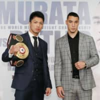WBA middleweight champion Ryota Murata (left) and challenger Steven Butler pose for a photo during a news conference on Thursday in Tokyo. | KYODO