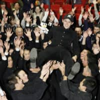 Pitcher Roki Sasaki is lifted up by his Ofunato High School classmates in Ofunato, Iwate Prefecture, on Thursday after the Chiba Lotte Marines selected him as the No. 1 pick in the NPB amateur draft. All 12 NPB teams nominate their first choice in secret, and the player's negotiating rights are decided by drawing lots. | KYODO