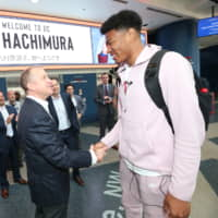 Rui Hachimura, seen being greeted by Washington Wizards GM Tommy Sheppard at Capital One Arena, has received major media attention in Japan since being drafted in the first round in June.   NBA PHOTOS