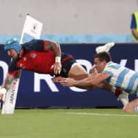 Jack Nowell scores England's fifth try against Argentina on Saturday. | REUTERS