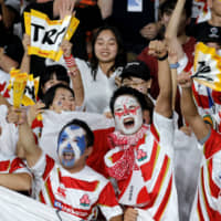 Fans cheer on the Brave Blossoms during the team's game against Scotland at the Rugby World Cup on Sunday in Yokohama. | AP