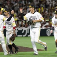 Hawks players celebrate their win over the Eagles on Sunday in Fukuoka. | KYODO