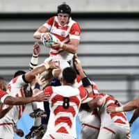 Japan's James Moore jumps for the ball in a lineout during Saturday's match against Samoa. | AFP-JIJI