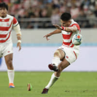 Japan's Yu Tamura kicks a penalty goal against South Africa in their Rugby World Cup quarterfinal on Sunday night. | AP