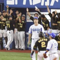 Hanshin players are fired up during the team's rally in the eighth inning on Saturday in Yokohama.   KYODO