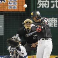 The Hawks' Kenta Imamiya slugs a two-run homer in the sixth inning against the Lions on Sunday at MetLife Dome. Imamiya belted three homers in Fukuoka SoftBank's 9-3 win over Seibu in the decisive Game 4 of the Pacific League Climax Series Final Stage. | KYODO