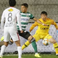 Matsumoto Yamaga's Ryo Nagai (center) is in the right place at the right time, with the ball deflecting off his right foot for a first-half goal against the visiting Kashima Antlers on Friday night in Matsumoto, Nagano Prefecture. | KYODO