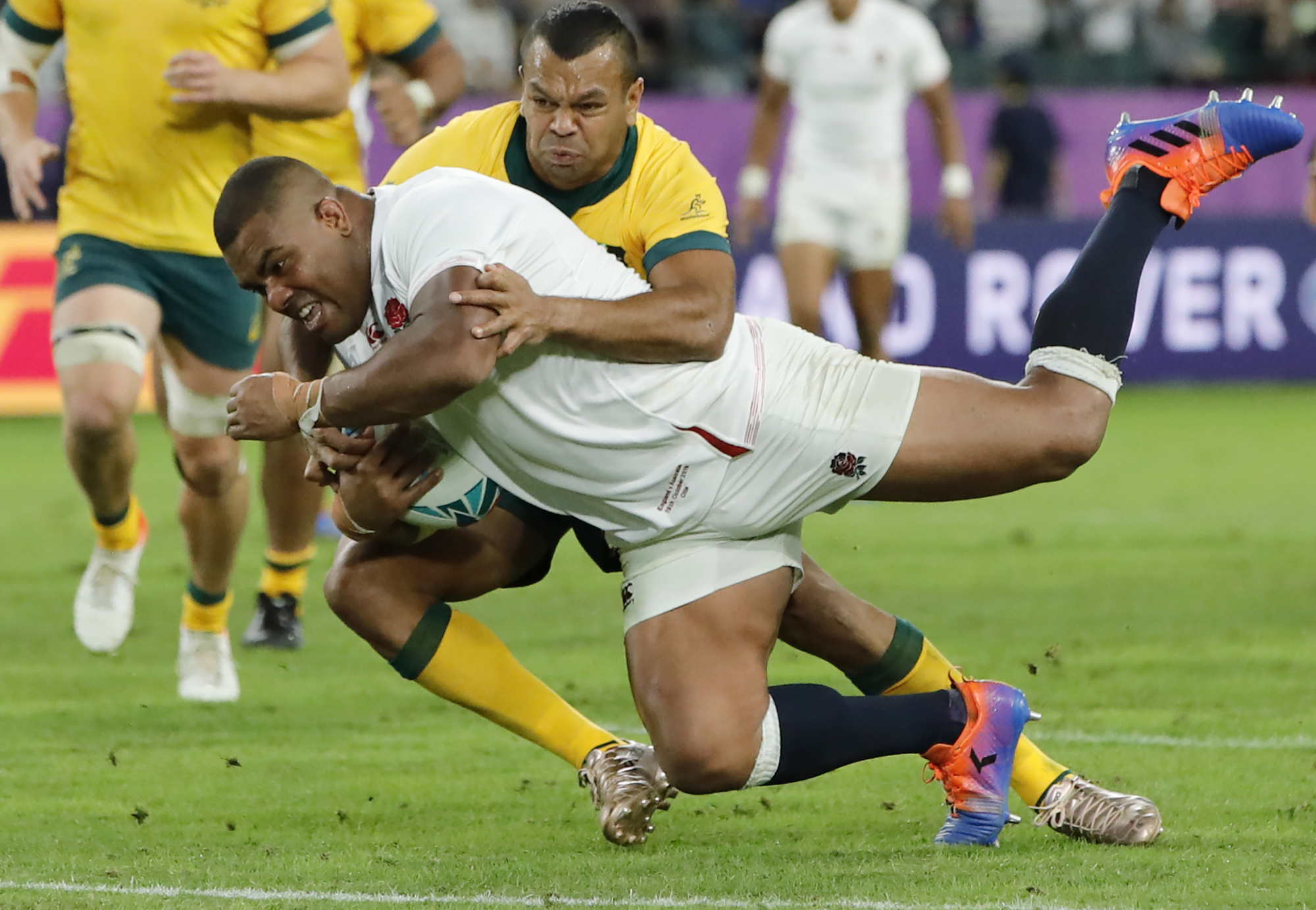 England's Kyle Sinckler scores a try against Australia in a Rugby World Cup quarterfinal match at Oita Stadium on Saturday. England beat Australia 40-16. | AP