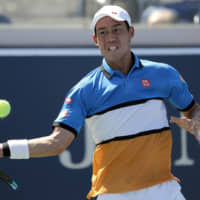 Kei Nishikori, seen in action at the U.S. Open in August, underwent surgery on his right elbow on Tuesday and will miss the rest of the ATP season. | AP