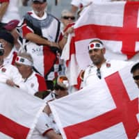 England fans cheer before the England-Argentina Rugby World Cup match at Tokyo Stadium last Saturday. | REUTERS