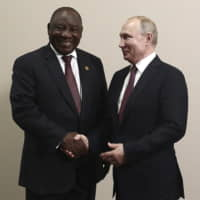 South African President, Cyril Ramaphosa (left), seen posing for a photo with Russian President Vladimir Putin in Sochi, Russia, on Oct. 23, will attend the Rugby World Cup final on Saturday in Yokohama. | AP