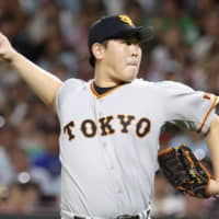 Yomiuri's Shun Yamaguchi pitches against the Hawks in Game 1 of the Japan Series on Saturday in Fukuoka. Yamaguchi was one of several potential candidates for the Sawamura Award, which will not have a recipient in 2019. | KYODO