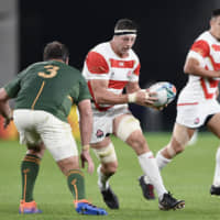 Brave Blossoms veteran Luke Thompson, who has announced his intention to retire from international rugby, carries the ball against South Africa during a Rugby World Cup quarterfinal on Sunday at Tokyo Stadium. | KYODO
