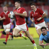 Wales' Gareth Davies scores his team's final try against Uruguay in a Rugby World Cup Pool D game at Kumamoto Stadium on Sunday. Wales defeated Uruguay 35-13. | AP