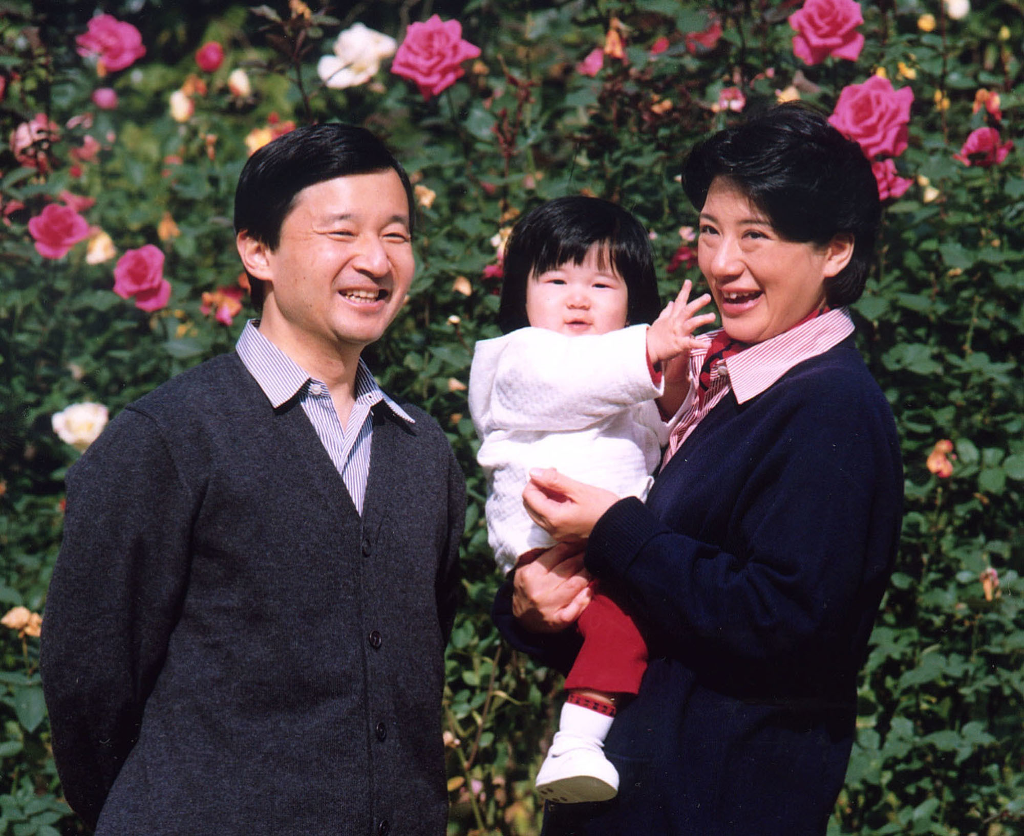 Crown Prince Naruhito and Crown Princess Masako with their daughter, Princess Aiko, on the grounds of the Akasaka Estate in Tokyo on Nov. 19, 2002. | IMPERIAL HOUSEHOLD AGENCY / VIA KYODO