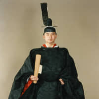 Prince Naruhito in traditional attire to celebrate his coming of age in February 1980. | KYODO