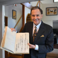 Andrew B. Arkley,  an Australian friend of Emperor Naruhito, holds a handwritten poem and message from the emperor in 1976 at his home in Yokohama on Sept. 19 . | SATOKO KAWASAKI