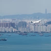 A Cathay Pacific flight flies over the city of Hong Kong in September. | REUTERS