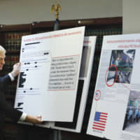 U.S. Attorney Richard P. Donoghue announces charges against Aventura Technologies Thursday in the Brooklyn borough of New York. The New York company has been charged with illegally importing and selling Chinese-made surveillance and security equipment to U.S. government agencies and private customers. | AP