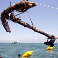 A 3,000 pound anchor from what is believed to be the wreck of the pirate Blackbeard's flagship, the Queen Anne's Revenge, is recovered from the ocean where it has been since 1718, in Beaufort Inlet, in Carteret County, North Carolina, in 2011. John Masters of Florida-based Intersal Inc. says he plans to seek $140 million in damages from the state following the ruling from the North Carolina Supreme Court that the case must return to Business Court. | ROBERT WILLETT / THE NEWS