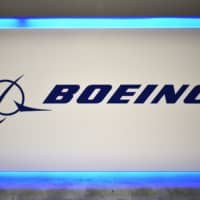 The Boeing logo is seen during the 70th annual International Astronautical Congress at the Walter E. Washington Convention Center in Washington last month. Boeing on Monday said it expected the 737 Max airplane, which was grounded after two crashes killed 346 people, to resume flying in January. 'In parallel, we are working towards final validation of the updated training requirements, which must occur before the MAX returns to commercial service, and which we now expect to begin in January,' Boeing said.   AFP-JIJI