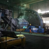 Workers monitor mineral selection at the Donghuashan Copper Mine, operated by Tongling Nonferrous Metals Group Co., Ltd., in Tongling, China in January. | BLOOMBERG