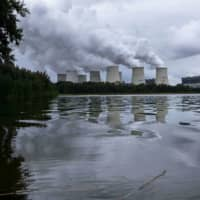 Emissions rise from cooling towers at the Jaenschwalde lignite-fired power plant, operated by Lausitz Energie Bergbau AG, in Germany. | BLOOMBERG