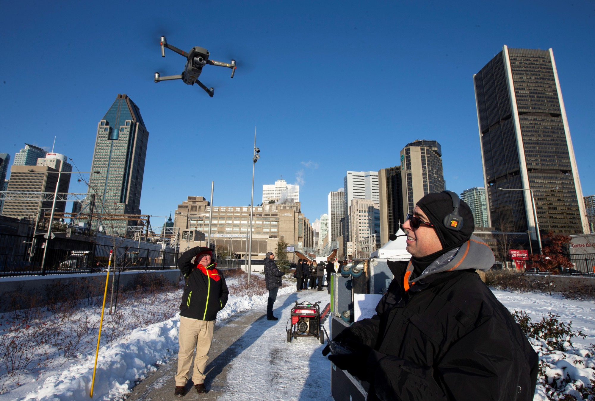A drone operator flies his drone as Chinese drone maker DJI holds a demonstration to display an app that tracks a drone's registration and owner, in Montreal, Quebec, Wednesday. | REUTERS