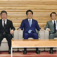 Prime Minister Shinzo Abe is seen before the start of a Cabinet meeting at the Prime Minister's Office on Friday. | KYODO