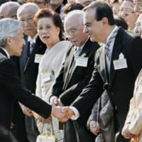 Nissan Motors' Carlos Ghosn is welcomed by Emperor Akihito during an annual autumn garden party in Tokyo in in October 2004. | AFP-JIJI