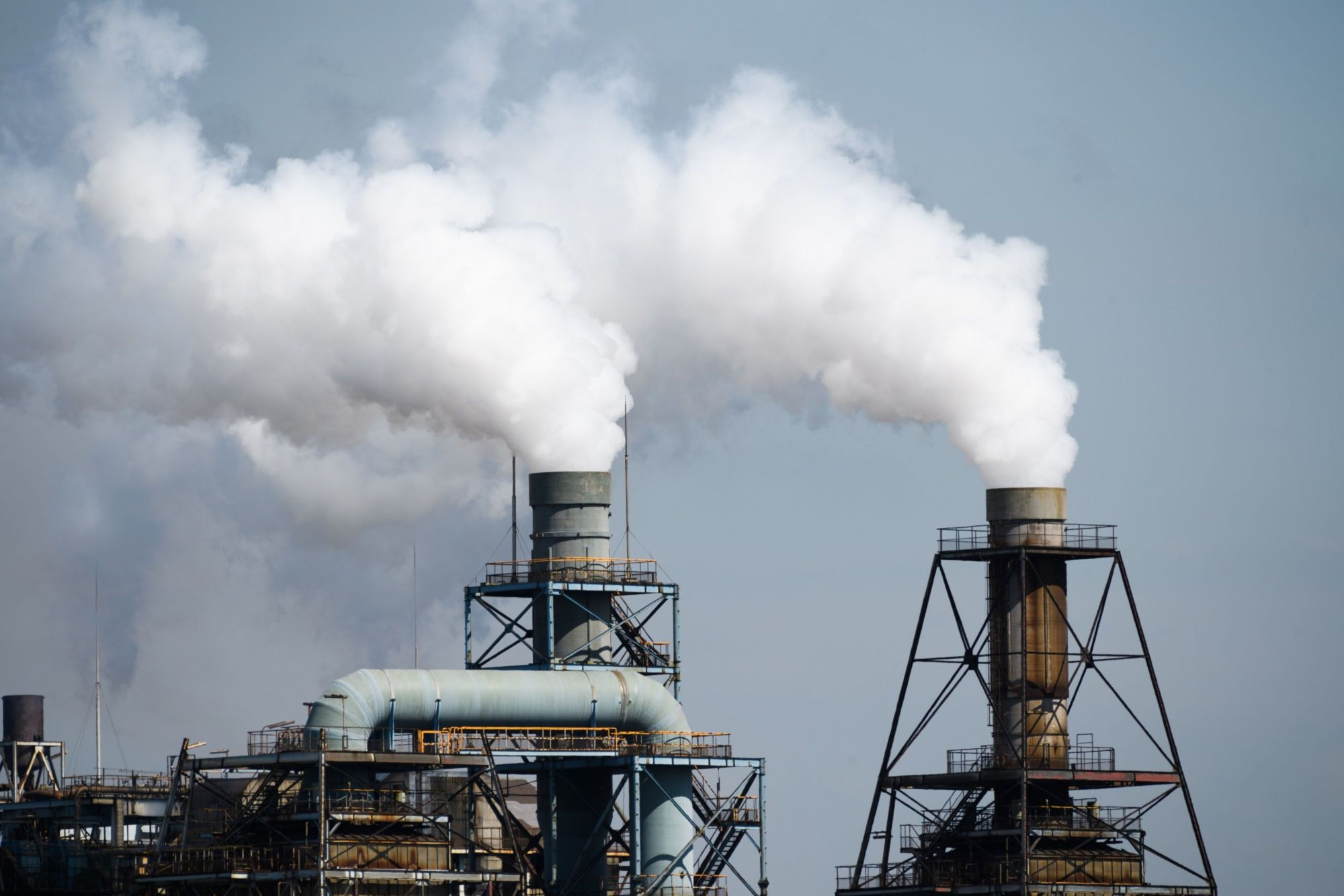 Steam rises from stacks in the Keihin industrial area of Kawasaki in September. | BLOOMBERG