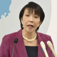 Communications minister Sanae Takaichi speaks during a news conference Friday in Tokyo. She said she has called on NHK to review the costs of its envisaged plan for real-time distribution of all television programs via the internet. | KYODO