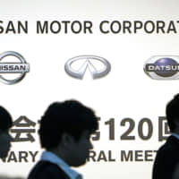 Nissan Motor Co. shareholders arrive for a meeting in Tokyo on June 25.   BLOOMBERG
