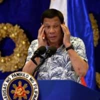 Philippine President Rodrigo Duterte gestures during a press conference at the Malacanang Palace in Manila on Tuesday | AFP-JIJI