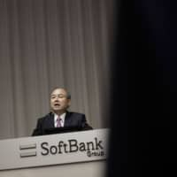 Masayoshi Son, chairman and chief executive officer of SoftBank Group Corp., speaks during a news conference in Tokyo on Nov. 6. | BLOOMBERG