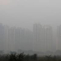 Buildings are engulfed in fog in Noida on the outskirts of New Delhi Nov. 14. | REUTERS