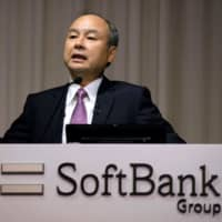 SoftBank Group CEO Masayoshi Son answers questions during a news conference on the company's financial results in Tokyo on Wednesday, announcing that the firm suffered an operating loss of $6.4 billion in the second quarter, the worst in its history.   AFP-JIJI
