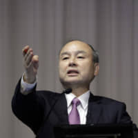 Masayoshi Son, chairman and chief executive officer of SoftBank Group Corp., takes a question during a news conference in Tokyo on Nov. 6. | BLOOMBERG