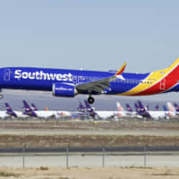 A Southwest Airlines Boeing 737 Max lands at the Southern California Logistics Airport in the high desert town of Victorville, California, in March. The union president of Southwest Airlines pilots worries that Boeing may be rushing the 737 Max back into service, and he says Southwest should consider buying planes from another company. | AP